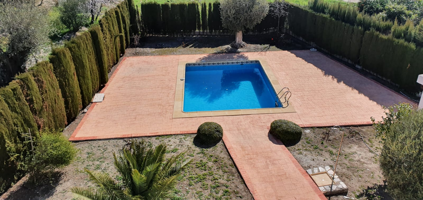 4 Bedroom House in gated community with swimming pool and gardens.